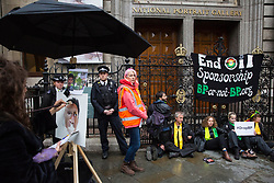 London, UK. 10 June, 2019. Activists from BP or not BP? block access to the National Portrait Gallery in protest against BP's sponsorship of the BP Portrait Award. The energy company has sponsored the National Portrait Gallery's award for 30 years, but its high-profile involvement is attracting widespread criticism due to the intensifying focus on environmental issues. A number of artists, including previous award winners such as Wim Heldens and Craig Wiley, have called on the gallery to end its sponsorship by BP.