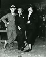 1936 Myrna Loy's hand/footprint ceremony at Grauman's Chinese Theater with William Powell (left) and Sid Grauman (center)