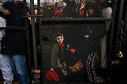The Inauguration of President Barack Obama. Washington DC, January 20, 2009. A boy trapped along a fence at a security checkpoint near the Parade route.