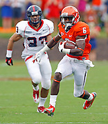 Virginia Cavaliers wide receiver Darius Jennings (6) runs a ctach in for a touchdown in front of Richmond Spiders defensive back Doug Howell (33) during the first half of the NCAA football game Saturday September, 1, 2012 at Scott Stadium in Charlottesville, Va.