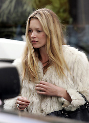 Jan 26, 2005; London, England, UK; British 'supermodel' KATE MOSS leaves a restaurant in Bayswater. Her partying is taking its toll as she is looking tired and sporting a big spot on her cheek, which could be from all the make-up..  (Credit Image: Big Pictures/ZUMAPRESS.com)