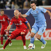 NEW YORK, NEW YORK - November 06: Frank Lampard #8 of New York City FC is challenged by Michael Bradley #4 of Toronto FC  during the NYCFC Vs Toronto FC MLS playoff game at Yankee Stadium on November 06, 2016 in New York City. (Photo by Tim Clayton/Corbis via Getty Images)