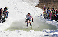 Warwick, NY - A skier wearing shorts and a tie-dye t-shirt crosses the water at the end of a run during the Spring Rally at Mount Peter in Warwick on March 29, 2008.