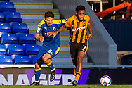 AFC Wimbledon defender Will Nightingale (5) battles for possession with Hull City forward Mallik Wilks (7) during the EFL Sky Bet League 1 match between AFC Wimbledon and Hull City at Plough Lane, London, United Kingdom on 27 February 2021.