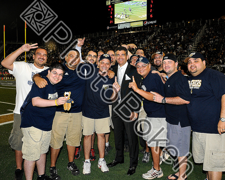 2011 October 25 - FIU Sports Athletic Director Pete Garcia with fans of Section 112. Florida International University Golden Panthers defeated the Trojans of Troy, 23-20 in overtime, at Alfonso Field, Miami, Florida. (Photo by: www.photobokeh.com / Alex J. Hernandez) 1/250 f/5.6 ISO640 25mm