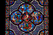 Medieval stained glass Window of the Gothic Cathedral of Chartres, France - dedicated to the lGood Samaritan . Central panel shows Adam dwelling in Paradise, below - At the inn, the Samaritan nurses the injured man back to health, left - God breathing life into Adam, above - God warning Adam and Eve not to eat from the tree of knowledge, right - God creates Eve out of Adam's rib .  A UNESCO World Heritage Site.. .<br /> <br /> Visit our MEDIEVAL ART PHOTO COLLECTIONS for more   photos  to download or buy as prints https://funkystock.photoshelter.com/gallery-collection/Medieval-Middle-Ages-Art-Artefacts-Antiquities-Pictures-Images-of/C0000YpKXiAHnG2k