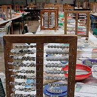 Africa, Kenya, Nairobi. Bead Drying Rack at the Kazuri bead making factory in Nairobi.