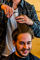 An after picture of a 24 year old man after having an extreme haircut, including cutting off a long ponytail for charity. Littleton, Colorado USA.