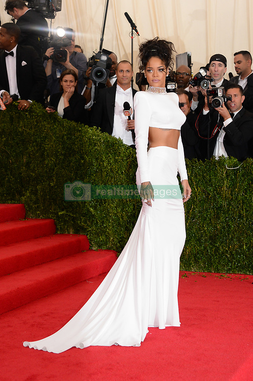 Rihanna attends the 2014 Metropolitan Museum of Art's Costume Institute Benefit Gala celebrating the opening of the exhibition 'Charles James: Beyond Fashion' and the new Anna Wintour Costume Center, in New York City, NY, USA on May 5, 2014. She is wearing a shirt and skirt by Stella McCartney. Photo by Briquet-Douliery/ABACAPRESS.COM  | 446025_846 New York City Etats-Unis United States