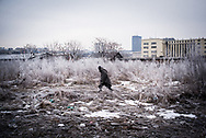 A migrant wrapped in a wool blanket is seen walking in the makeshift camp during a snow storm. Belgrade, Serbia. January 16th 2017. Federico Scoppa