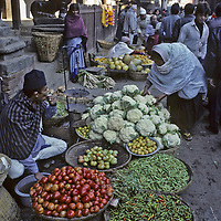 NEPAL, Kathmandu. Outdoor vegetable market by temple at Durbar Square.
