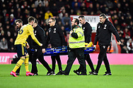 Shkodran Mustafi (20) of Arsenal is carried off on a stretcher after being injured with Rob Holding (16) of Arsenal replacingduring the The FA Cup match between Bournemouth and Arsenal at the Vitality Stadium, Bournemouth, England on 27 January 2020.