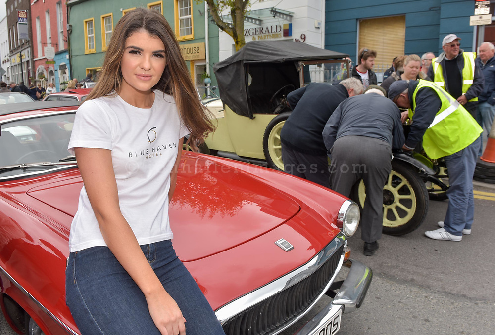 REPRO FREE<br /> Hope Hickey from Lockdown models pictured at the start of the Blue Haven Kinsale Vintage Rally on Saturday.<br /> Picture. John Allen<br /> <br /> Kinsale Vintage Rally Weekend 2017(May 5th- 8th) <br /> <br /> One the most exciting and spectacular weekends on the Kinsale events is The Blue Haven Kinsale Vintage Rally, taking place this weekend May 5th to 8th. With over 100 amazing Vintage cars on display in Kinsale over the weekend, it really is a fun filled family weekend worth seeing. Blue Haven Kinsale are proud sponsors and partners for over 10 years of the Kinsale Vintage Rally. The Vintage Cars were on display today Saturday 6th May outside The Blue Haven Hotel from 9.30am, with special guest from Lockdown model agency and many people who were out to see this great event which takes place once a year. It's a fantastic day for the whole family and is enjoyed by all. <br /> <br /> Now entering its 28th year, it is widely regarded as one of the premier events on the Irish classic car calendar.<br /> <br /> Following the twinning of Kinsale with the Welsh town of Mumbles in 1990, KVCMC also decided to twin with the town's own car club, The Swansea Historic Vehicle Register. Each year see's large numbers of SHVR members make the trip to Kinsale for the May rally, a gesture that is returned each July when the club makes the return trip to Swansea.<br /> <br /> Kinsale Vintage & Classic Motor Club originally established in 1988 by a group of classic car enthusiasts, the club has since grown to a current membership of over 100 members. All members share a common passion –their love of driving and preserving the classic cars. Indeed, one could ask for no better setting than the historic town of Kinsale and the surrounding beauty of the West Cork countryside.<br /> <br /> For more details please contact  cassandra@bluehavenkinsale.com or call 021-4772209 or Cathal O'Shea- Chairman KVCMC on 086-2486496