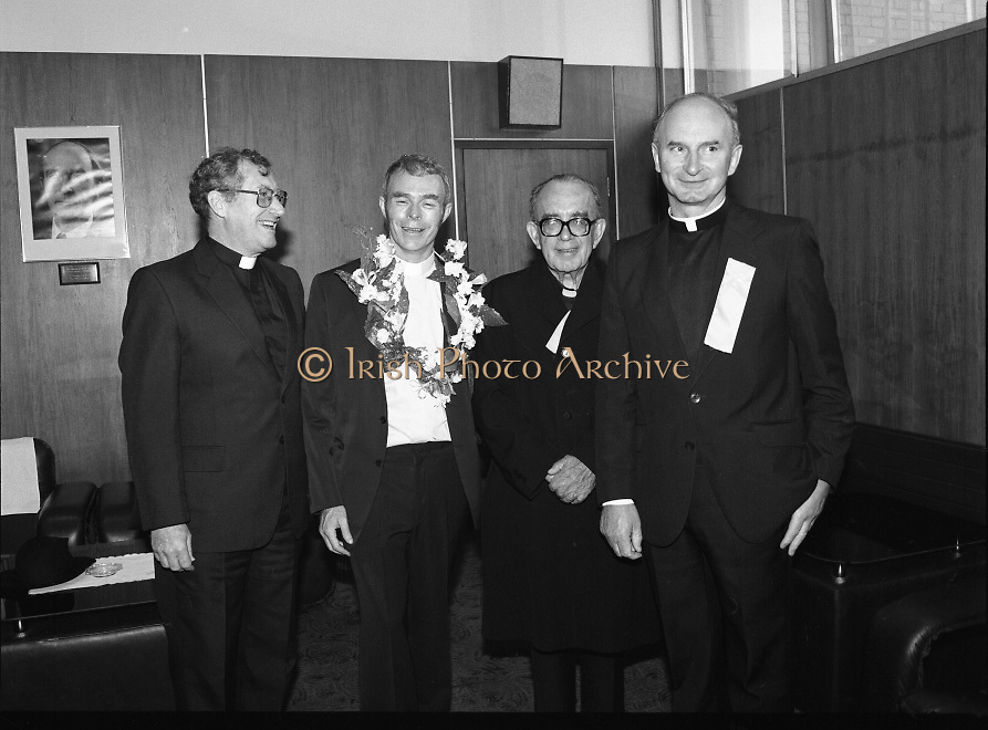 """Fr Niall O'Brien Returns from Captivity.1984..14.07.1984..07.14.1984..On 6 May 1983,Fr Niall O'Brien was arrested along with two other priests, Fr. Brian Gore, an Australian, Fr. Vicente Dangan, a Filipino and six lay workers - the so-called """"Negros Nine"""", for the murders of Mayor Pablo Sola of Kabankalan and four companions. The priests where held under house arrest for eight months but """"escaped"""" to prison in Bacolod City, the provincial capital, where they felt they would be safer.The case received widespread publicity in Ireland and Australia, the home of one of the co-accused priests, Fr. Brian Gore. When Ronald Reagan visited Ireland in 1984, he was asked on Irish TV how he could help the missionary priest's situation. A phone call the next day from the Reagan administration to Ferdinand Marcos resulted in Marcos offering a pardon to Fr. O'Brien and his co-accused..(Ref Wikipedia)...Image shows Fr Niall  O'Brien with members of his order in the V I P Lounge in Dublin Airport."""