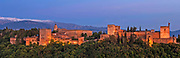 The Alhambra Palace in Granada, with the snow covered peaks of the Sierra Nevada beyond, Andalucia