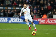 Ki Sung-Yueng of Swansea city in action. Premier league match, Swansea city v West Bromwich Albion at the Liberty Stadium in Swansea, South Wales on Saturday 9th December 2017.<br /> pic by  Andrew Orchard, Andrew Orchard sports photography.