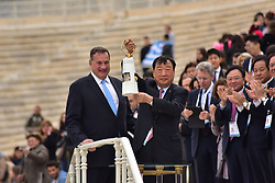 October 31, 2017 - Athens, Attiki, Greece - President of the Hellenic Olympic Committee Spyros Capralos (left) and President of the Organising Committee for the XXIII Winter Olympics Games 'PYEONGCHANG 2018 Lee Hee Beom (right), who is holding the Olympic Flame. The Handover Ceremony of the Olympic Flame for Winter Games PYEONGCHANG 2018, took place today in Panathenaic Stadium in the presence of the President of Hellenic Republic Prokopis Pavlopoulos. (Credit Image: © Dimitrios Karvountzis/Pacific Press via ZUMA Wire)