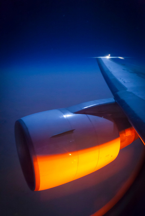 Engine cowling illuminated by moonlight and the aircraft belly strobe, somewhere over North Africa.  <br /> <br /> Created by aviation photographer John Slemp of Aerographs Aviation Photography. Clients include Goodyear Aviation Tires, Phillips 66 Aviation Fuels, Smithsonian Air & Space magazine, and The Lindbergh Foundation.  Specialising in high end commercial aviation photography and the supply of aviation stock photography for advertising, corporate, and editorial use.