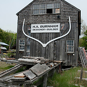 Harold Burnham is the 28th member of his family to design and build boats on the Essex River in Essex, Massachusetts