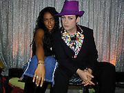 Aaliyah and Boy George.MTV 20th Birthday Bash (backstage).Hammerstein Ballroom.New York, NY.August 01, 2001.Photo by Celebrityvibe.com..