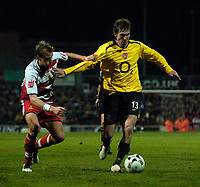 Photo: Jed Wee.<br /> Doncaster Rovers v Arsenal. Carling Cup. 21/12/2005.<br /> <br /> Arsenal's Alexander Hleb (R) tries to keep Doncaster's Ricky Ravenhill at arms length.