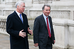 London, UK. 6th December, 2018. Sir Michael Fallon, Conservative MP for Sevenoaks, and Sir Oliver Letwin, Conservative MP for  West Dorset, arrive for a Privy Council meeting at the Cabinet Office.
