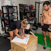 Natalie Saito and Mark Batres run a Spartan virtual Sprint at their home during 2020 quarantine: August 18, 2020 in Clairmont, California.