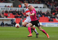 Marcus Maddison of Peterborough United holds off a challenge from Andrew Butler of Doncaster - Mandatory byline: Joe Dent/JMP - 19/03/2016 - FOOTBALL - The Keepmoat Stadium - Doncaster, England - Doncaster Rovers v Peterborough United - Sky Bet League One