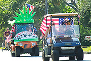 Families ride decorated golf cart during the annual Sullivan's Island Independence Day parade July 4, 2017 in Sullivan's Island, South Carolina. The tiny affluent sea island hosts a bicycle and golf cart parade through the historic village.
