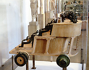 Greek war chariot c5th-3rd century BC. Reconstruction with original finds incorporated. Archaeological Museum of Thessaloniki