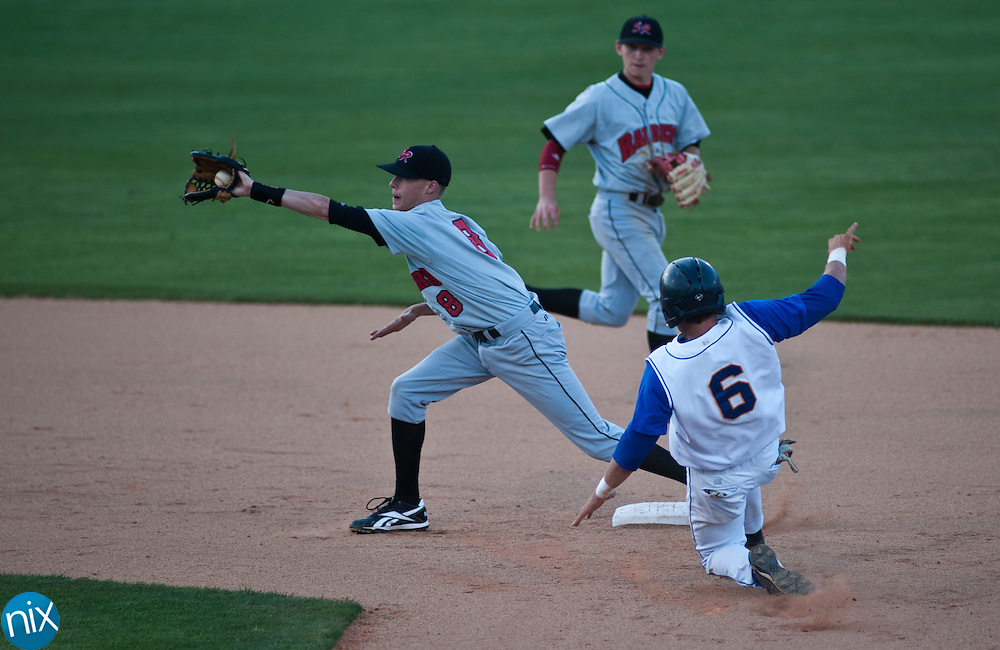 Mount Pleasant's Brondon Burris attempts to steal second but is tagged out by South Rowan's Parker Hubbard during the F&M Bank High School Baseball Classic at Fieldcrest Cannon Stadium Thursday evening. Mount Pleasant won the game 10-7. (Photo by James Nix)