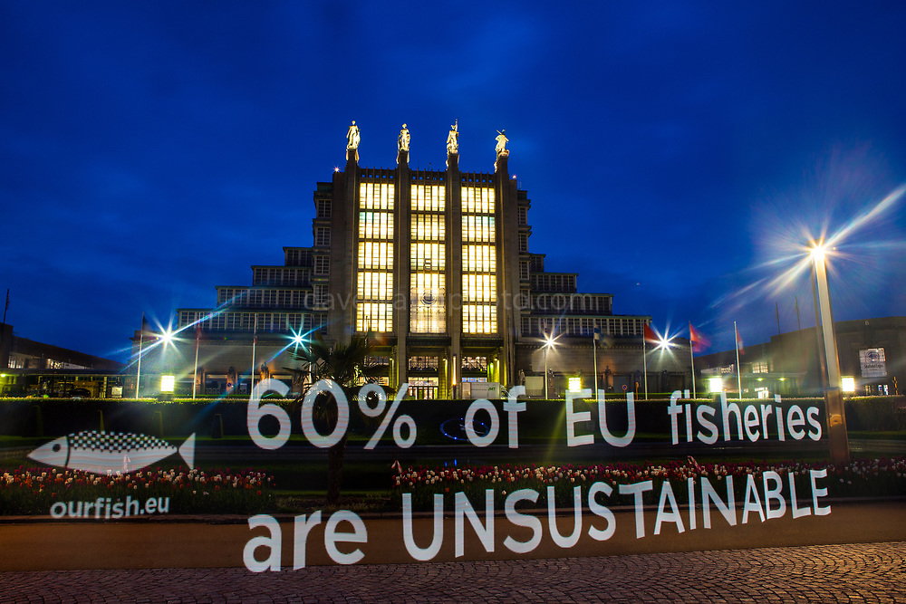 "Light painting projection by marine conservation campaign group Our Fish reading ""60% of EU Fisheries are unsustainable"" outside the Brussels Seafood Expo, which opens on April 25.  Despite the reformed Common Fisheries Policy coming into force in January 2014, many EU countries are falling behind in their obligations to enforce the new rules, leading to continuation of unsustainable fishing in Europe's waters. According to a recent EU Scientific, Technical and Economic Committee for Fisheries (STECF) report, six out of ten North Atlantic fisheries are unsustainable, while the Mediterranean is 96% overfished. <br /> <br /> Photo Copyright Our Fish/Dave Walsh. Permission granted for publication regarding 2017 Global Seafood Expo. Credit line must be included. <br /> <br /> <br /> Our Fish works to ensure European member states implement the Common Fisheries Policy and achieve sustainable fish stocks in European waters.<br /> <br /> Our Fish brings together organisations from across Europe to speak with a common voice: overfishing of our waters must be stopped, and solutions put in place that ensure Europe's waters are fished sustainably. Our Fish demands that the Common Fisheries Policy be properly enforced, and Europe's fisheries effectively governed.<br /> <br /> Our Fish calls on all EU Member States to set annual fishing limits at sustainable limits based on scientific advice, and to ensure that their fishing fleets prove that they are fishing sustainably, through monitoring and full documentation of their catch.<br /> http://www.ourfish.eu"
