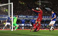 Liverpool's Mohamed Salah appears frustrated as Sadio Mane (behind) heads toward goal during the Premier League match at Goodison Park, Liverpool.