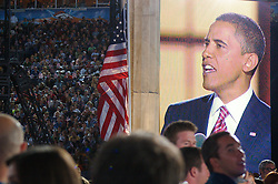 A closeup of Sen. Barack Obama on the jumbo screen as he delivers his Democratic Presidential Nominee acceptance speech on Thursday, August 28, the Democratic National Convention, Invesco Field at Mile High Stadium, Denver Colorado.  Supporters in the front rows can be seen at the bottom of the shot - they are looking at Obama on stage as he appears on the big screen seemingly looking the other way. Crowds can be seen in the stands at left.