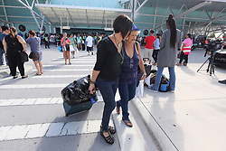 Wanda Collazo escorts her mother Marta Collazo from the arrival area as she departs the Adventure of the Seas after being evacuated from her apartment in Puerto Rico. (Emily Michot/Miami Herald/TNS)