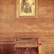 Organ and painting of God, Cataldo Mission, Idaho, Shoshone County, Cataldo. The Cataldo Mission is the oldest standing building in the state of Idaho and part of the Cataldo Mission State Park.