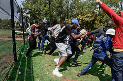 Oct. 20, 2016 - Pretoria, South Africa - Protesting college students run away as police officials try to disperse them outside the Union Buildings, the official seat of the South African government. The latest wave of student protests has continued for weeks since universities were given the green light by the government last month to raise tuition fees, provided that it does not exceed eight percent. Students are demanding zero-percent fee increase and pressing the ruling African National Congress to live up to its promise to provide free education by 2016.  (Credit Image: © Zhai Jianlan/Xinhua via ZUMA Wire)