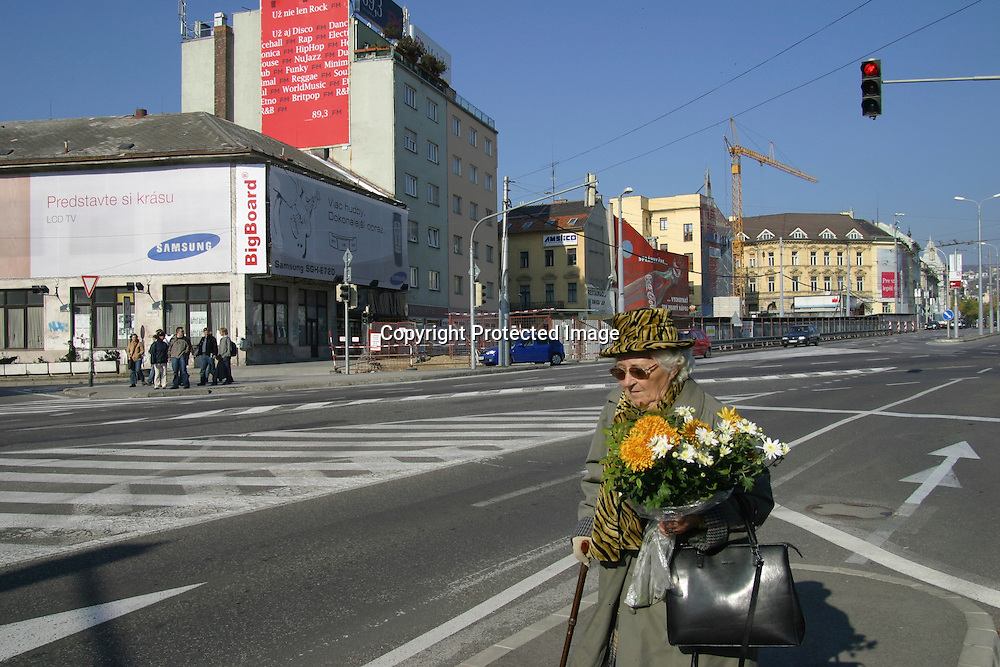 old woman with flowers in Bratislava, Slovakia