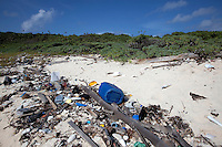 Marine debris including trash and plastics washed up along the shore of Swan Island, located 90 miles off the coast of Honduras.