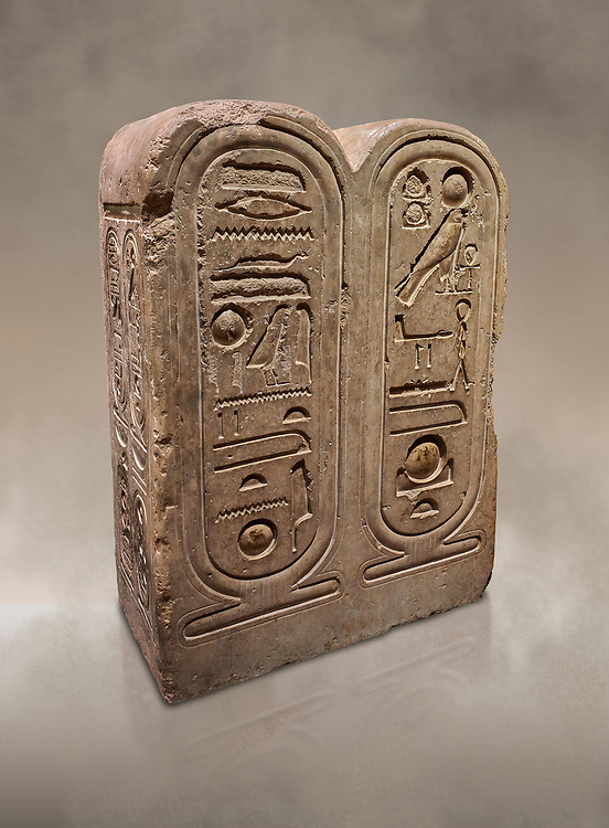 """Ancient Egyptian architectonic element of the temple of Aten, Karnak, limestone, New Kingdom 18th Dynasty (1353-1336 BC). Egyptian Museum, Turin. <br /> This crystaline block from the riugn of Amenhoptep IV was part of the railing of the temple of Aten in Karnak. It is os a double form cartouche, which usually enclose the name of the king. Here insted, it contains the names of the sun disk Aten, the one god of King Akhenaten : """"Ra-Harakhty rising in the Horizon"""" """"in the name as the light which is in Aten"""". The name of the king is carved on the sides. The objects is therefore a links god with the pharoah. Drovetti collection Cat 1378 .<br /> <br /> If you prefer to buy from our ALAMY PHOTO LIBRARY  Collection visit : https://www.alamy.com/portfolio/paul-williams-funkystock/ancient-egyptian-art-artefacts.html  . Type -   Turin   - into the LOWER SEARCH WITHIN GALLERY box. Refine search by adding background colour, subject etc<br /> <br /> Visit our ANCIENT WORLD PHOTO COLLECTIONS for more photos to download or buy as wall art prints https://funkystock.photoshelter.com/gallery-collection/Ancient-World-Art-Antiquities-Historic-Sites-Pictures-Images-of/C00006u26yqSkDOM"""