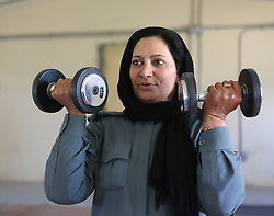 © London News Pictures. File pic dated 29/05/2012. Afghan female police officer ISLAM BIBI (pictured) who has been has been shot dead outside her home. Lieutenant Islam Bibi, 37, was targeted by a gunman as she rode on a motorbike with her son-in-law on her way to work on Thursday morning. Pictured here in training in Helmand region. Photo credit : Alison Baskerville/LNP