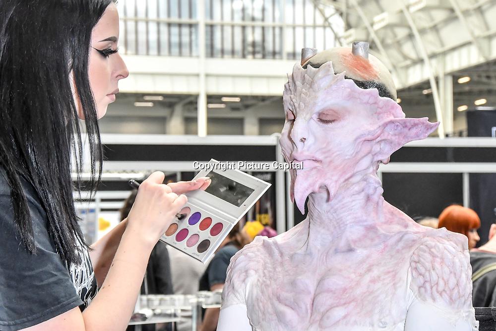 Screenface London, make up artist by Zoe Richardson and model Lucy barylski - avant-garde high fashion demo at IMATS London on 18 May 2019,  London, UK.