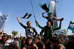 October 14, 2017 - Anjara, Aleppo, Syria - A 'Day of Rage' demonstration takes place in Anjara, in the western Aleppo countryside. The demonstration is part of a series of rallies in opposition-controlled territories of Syria calling for the fall of the Syrian regime of Bashar al-Assad, to denounce what they describe as the massacres committed by the Russian airplanes in Syria, as well as to remember those who died and went to prison as they joined the Syrian revolution.  (Credit Image: © Juma Mohammed/ImagesLive via ZUMA Wire)