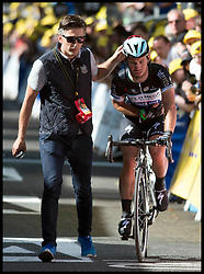 Image ©Licensed to i-Images Picture Agency. 05/07/2014. Yorkshire, United Kingdom.Mark Cavendish limps over the the Tour de Frrance finish line in Harrogate on stage one of the race after a fall  just  short of the finish line . Picture by Andrew Parsons / i-images