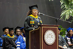 Nichole Etienne gives the address.  Fifty-first annual University of the Virgin Islands  Commencement Exercises.  UVI Sports & Fitness Center.  St. Thomas, VI.  14 May 2015.  © Aisha-Zakiya Boyd