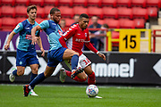 Wycombe Wanderers Curtis Thompson(18) in a tackle with Charlton Athletic forward Karlan Ahearne-Grant (18) during the EFL Sky Bet League 1 match between Charlton Athletic and Wycombe Wanderers at The Valley, London, England on 8 September 2018.