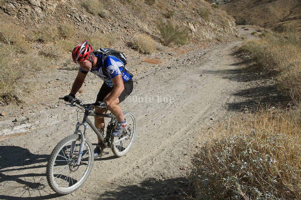 a mountain biker in the San Jacinto Mountain range near Palm springs USA