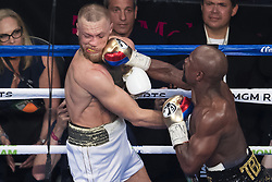 August 26, 2017 - Las Vegas, Nevada, U.S. - FLOYD MAYWEATHER connects a right hand to the face of CONOR MCGREGOR during fight in Las Vegas. May weather beats McGregor in 10 Rounds. (Credit Image: © Joel Marklund/Bildbyran via ZUMA Wire)