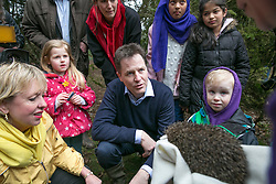 © Licensed to London News Pictures. 30/3/2015. Solihull, West Midlands, UK. Deputy Prime Minister Nick Clegg pictured on a visit to The Parkridge Centre, Brueton Park, Solihull. Nick Clegg met Warwickshire Wildlife Trust volunteers alongside Lorely Burt the Solihull M.P. Pictured, meeting a rescued hedgehog. Photo credit : Dave Warren/LNP