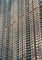 Facade with many balconies of high rise apartment block in Hang Hau new town in Hong Kong New Territories.